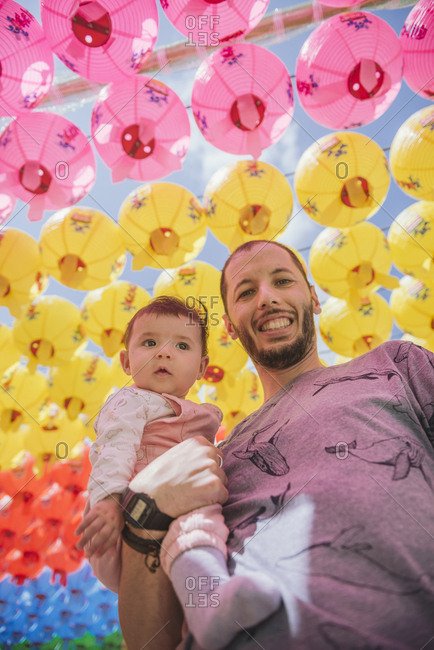 South Korea- Gyeongju- father with a baby girl under colorful paper lanterns at Bulguksa Temple