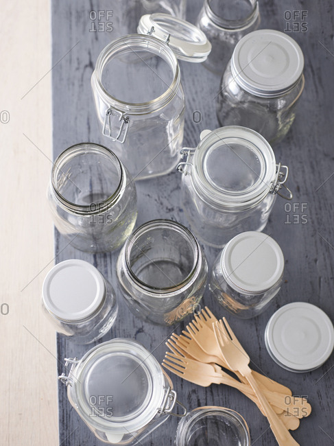 Various preserving jars and wooden forks