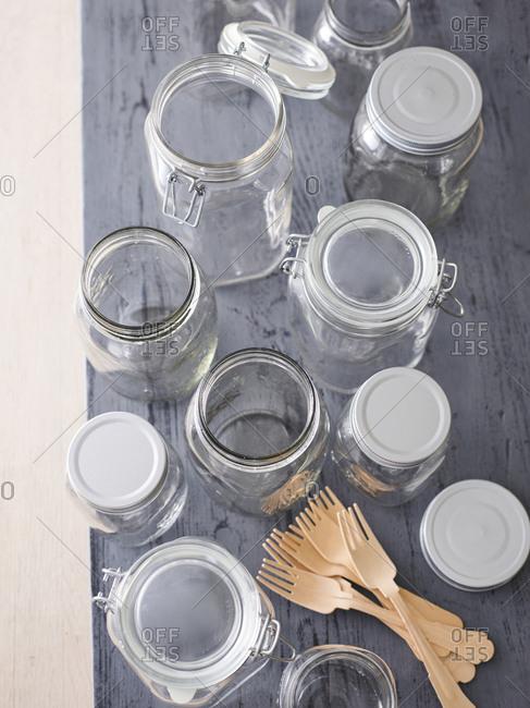Various preserving jars and wooden forks