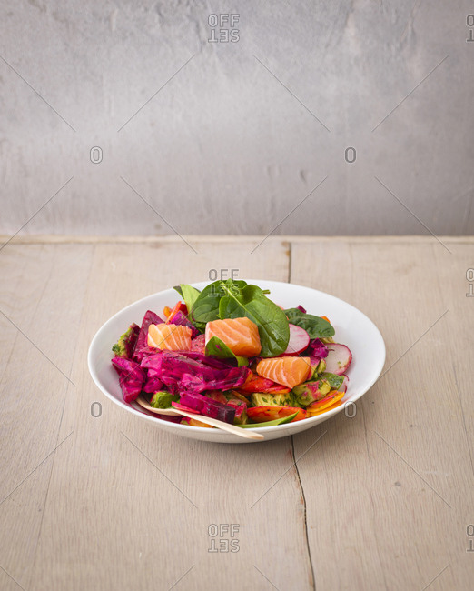 Plate of various vegetables with salmon