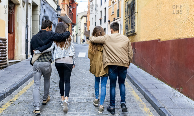 Two couples strolling in the city