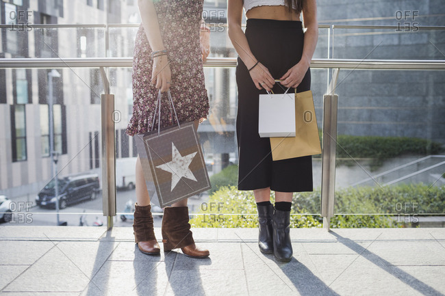 Two women with shopping bags in the city