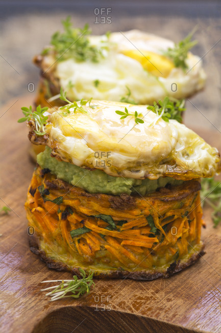 Sweet potato fritters with avocado dip and baked egg