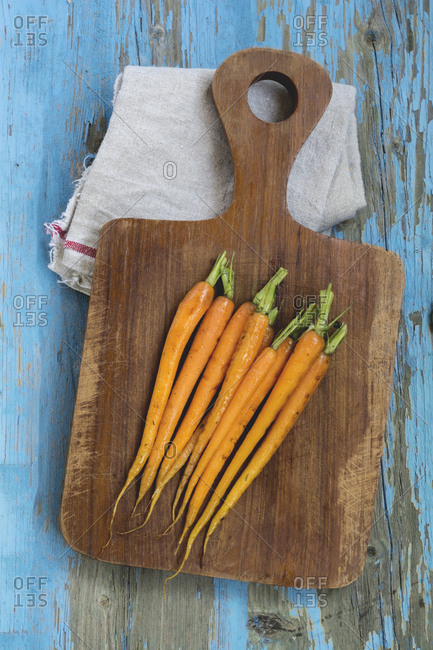 Grilled carrots on wooden board