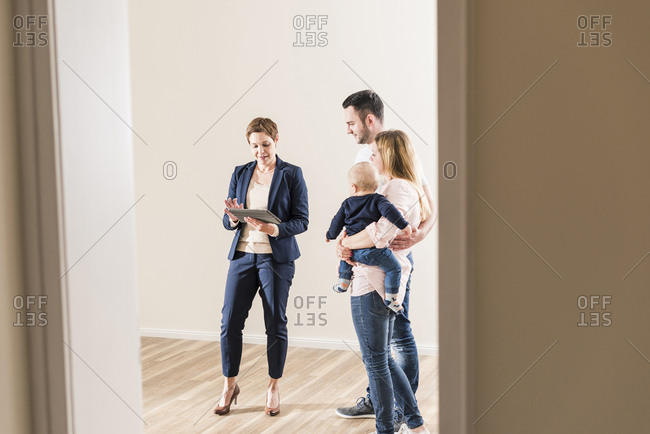Real estate agent and family in new apartment