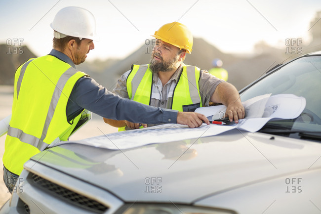 Quarry workers checking site plan