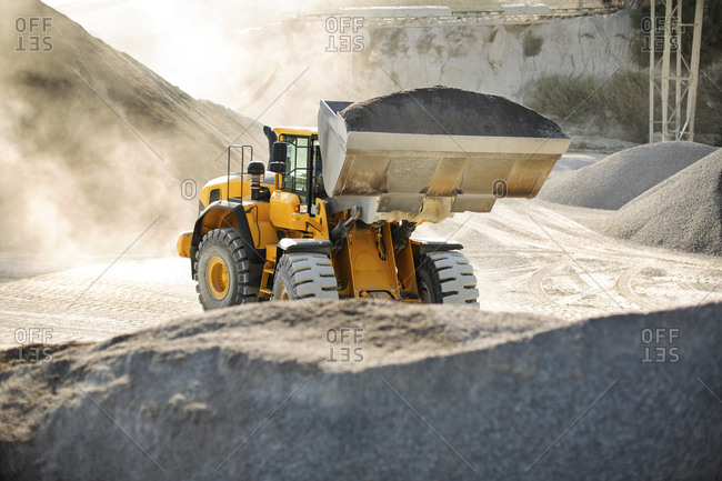 Digger working at quarry - Offset