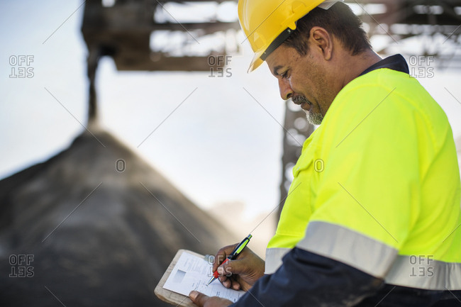 Worker wearing protective clothing standing at quarry