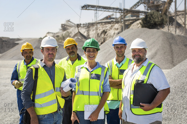 Team of quarry workers looking at camera- looking confident