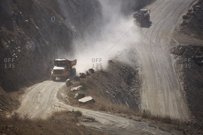 Trucks driving in quarry