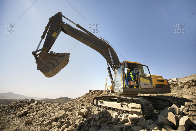 Digger working in quarry - Offset