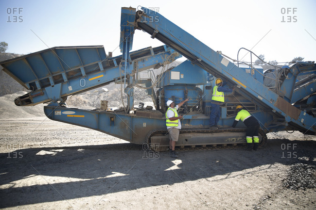 Workers in quarry maintaining dragline