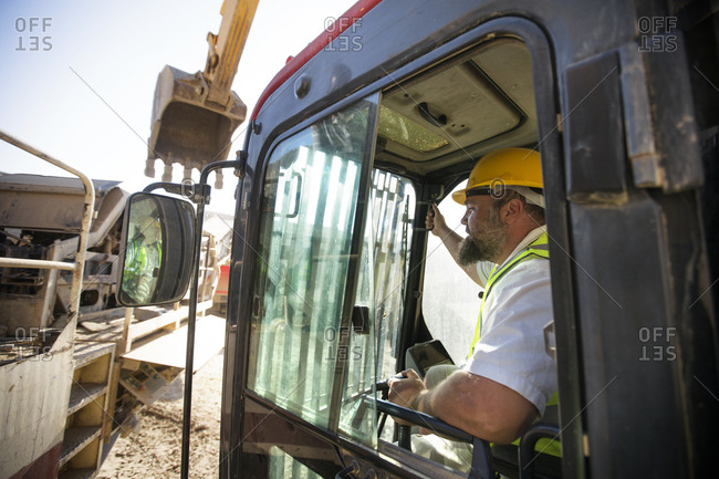 Worker driving a digger