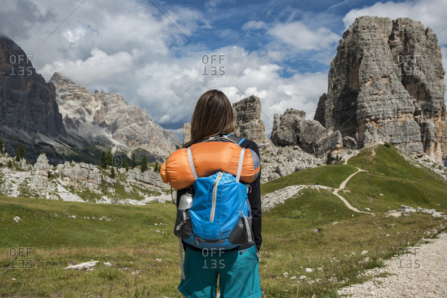 Italy- Woman trekking in the Dolomites
