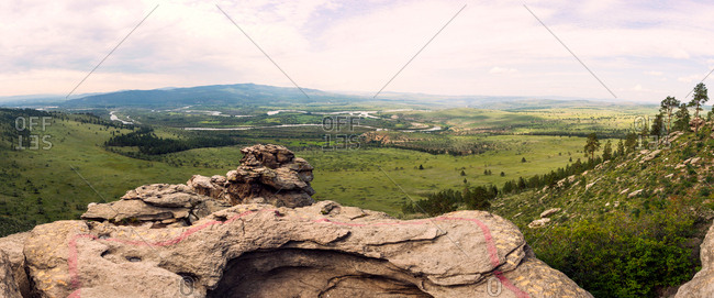 Panorama view of verdant Mongolia - Russia Border valley from rocky outcrop