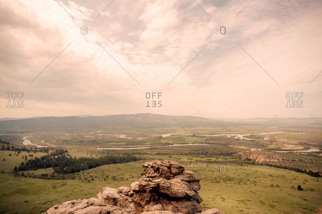 Scenic view of a green Mongolia - Russia Border valley from rocky outcrop