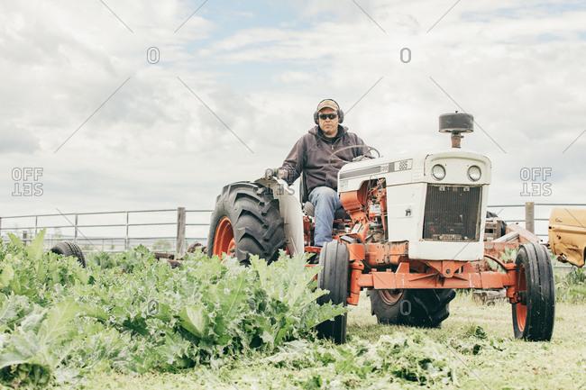 Umatilla Reservation, Pendleton, Oregon - May 17, 2017: Man riding on a tractor on the Umatilla Reservation in Oregon