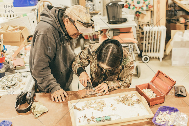 Umatilla Reservation, Pendleton, Oregon - May 17, 2017: Father and daughter working together in a workshop