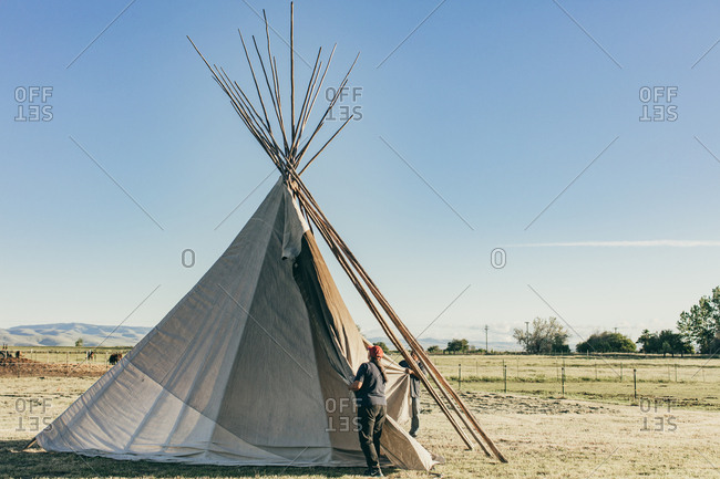 Umatilla Reservation, Pendleton, Oregon - May 18, 2017: Couple setting up a tipi