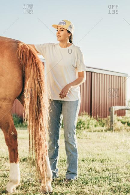 Umatilla Reservation, Pendleton, Oregon - May 18, 2017: Girl petting horse on the Umatilla Reservation in Oregon