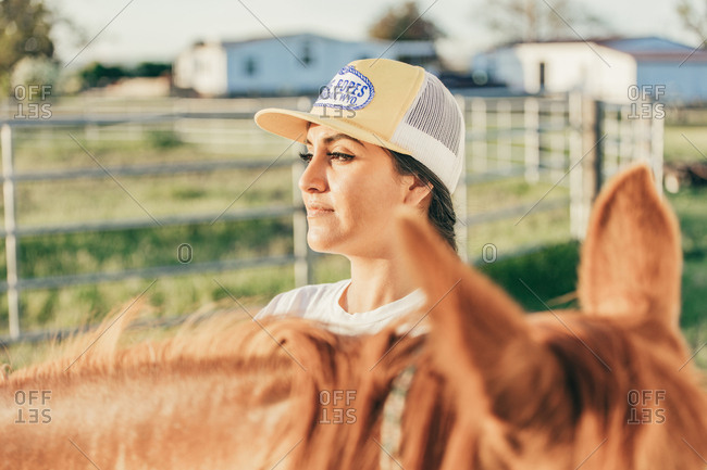Umatilla Reservation, Pendleton, Oregon - May 18, 2017: Girl by horse on the Umatilla Reservation in Oregon