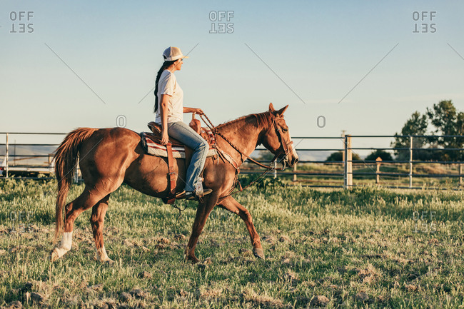 Umatilla Reservation, Pendleton, Oregon - May 18, 2017: Girl riding brown horse on the Umatilla Reservation in Oregon