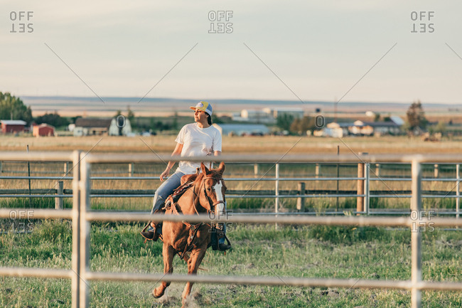 Umatilla Reservation, Pendleton, Oregon - May 18, 2017: Girl riding horse in a pen on the Umatilla Reservation in Oregon