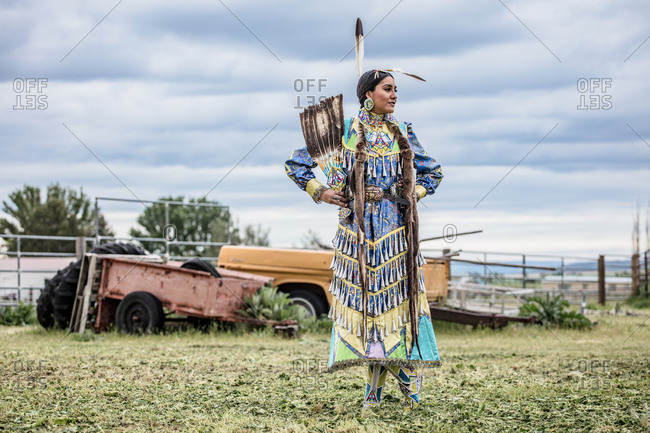 Umatilla Reservation, Pendleton, Oregon - May 17, 2017: Native American girl dressed in regalia on the Umatilla Reservation in Oregon looking away