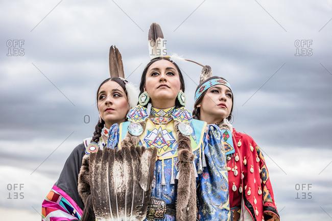 Umatilla Reservation, Pendleton, Oregon - May 17, 2017: Three Native American sisters dressed in regalia on the Umatilla Reservation in Oregon
