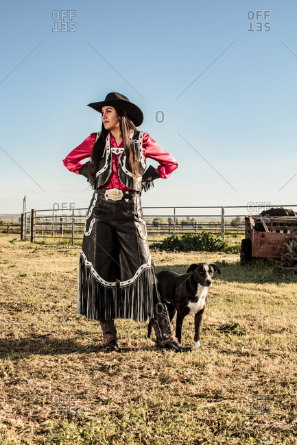 Umatilla Reservation, Pendleton, Oregon - May 18, 2017: Girl dressed in cow girl attire with dog on a Native American Reservation