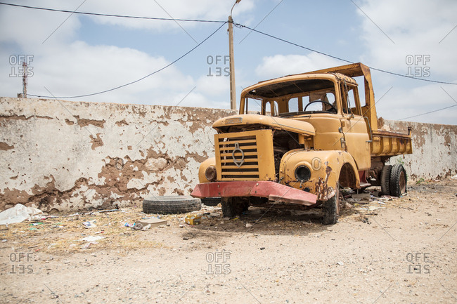 Morocco - June 19, 2017: Old truck by crumbling wall