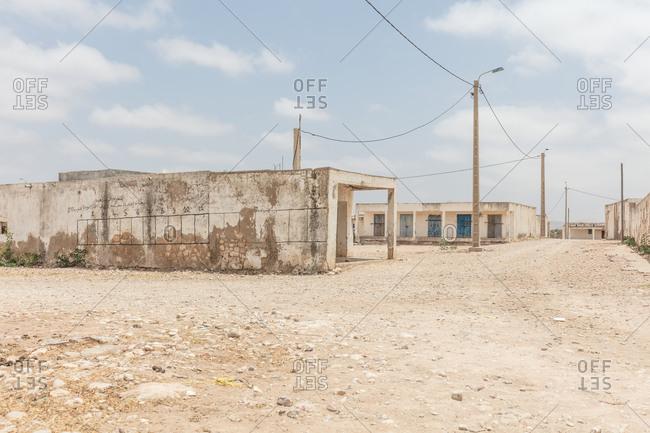 Morocco - June 19, 2017: Worn buildings in arid setting