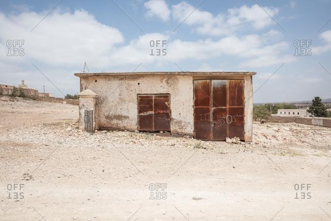 Morocco - June 19, 2017: Worn building in arid setting