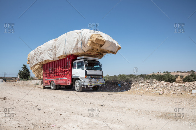 Morocco - June 20, 2017: Truck carrying hay bales