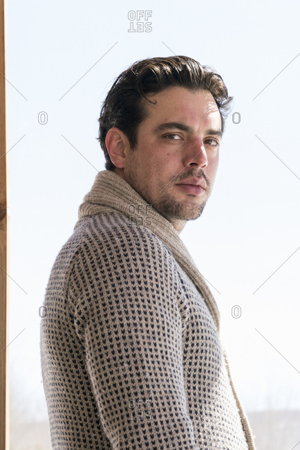 Handsome man in cardigan sweater