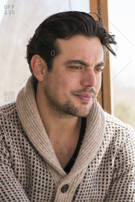 Portrait of man in cardigan sweater