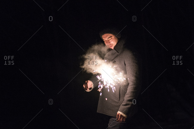 Man with a sparkler at night