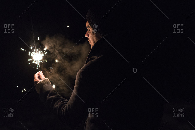 Man with a lit sparkler