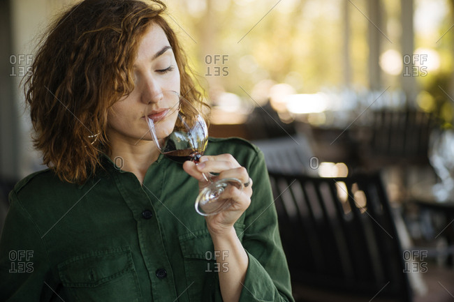 Woman drinking a glass of wine outdoors
