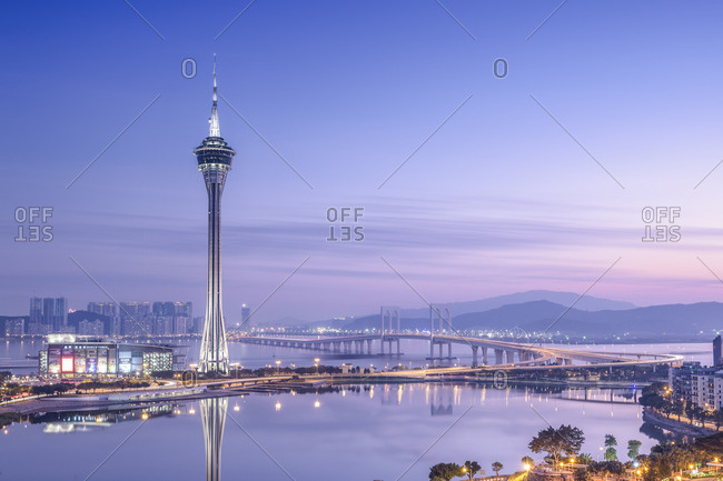 Se, Macau, China - December 20, 2014: Macau Tower and Sai Van Bridge at dusk