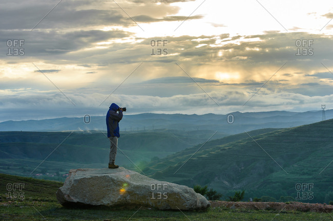 Zhangjiakou, China - August 24, 2014: Photographer of the grasslands near Zhangjiakou