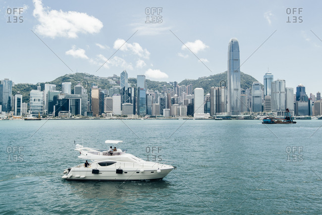 Hong Kong, China - August 15, 2014: A boat cruises on Hong Kong's Victoria Harbour