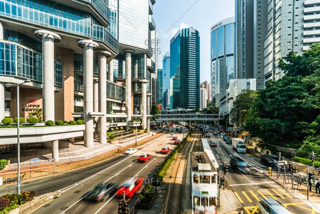 Hong Kong, China - November 17, 2014: Trains and city traffic near Lippo Centre