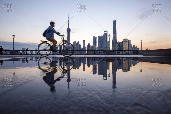 Shanghai, China - September 14, 2010: A bicyclist navigates past The Bund district