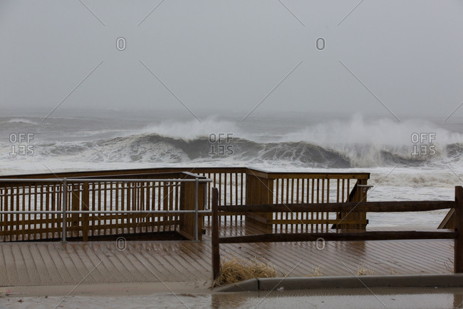 Stormy waves over a boardwalk
