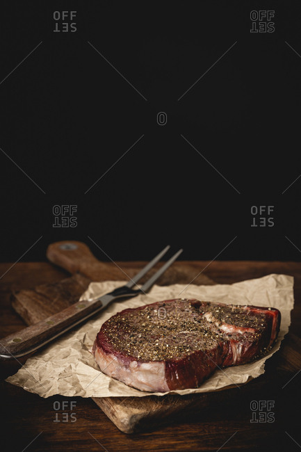 Raw steak with seasoning