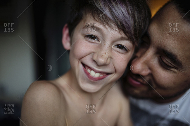 Dad hugging boy with dyed hair
