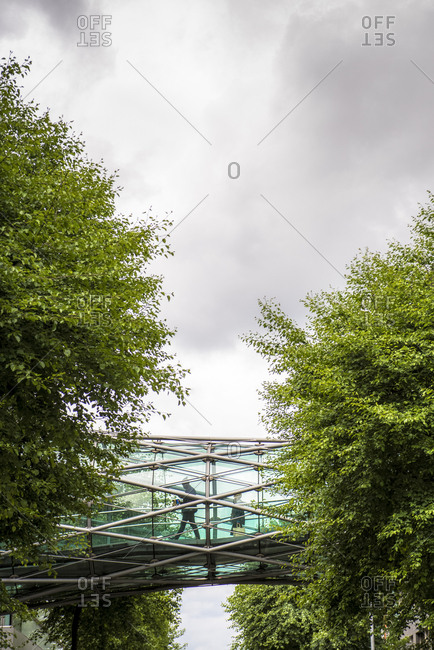 Yorkshire, England, UK - June 5, 2014: A glass and steel footbridge