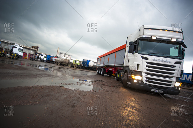 Yorkshire, England, UK - October 29, 2012: Cargo trucks in muddy lot