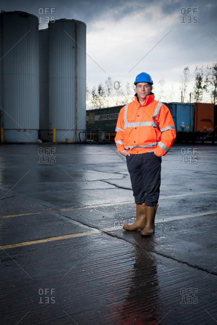 Yorkshire, England, UK - October 29, 2012: Industrial worker standing in lot
